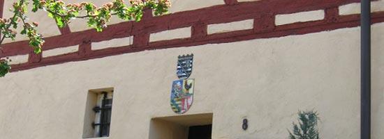 Fränkisches Wappen an einem Fachwerkhaus